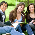 college or university students studying outdoors