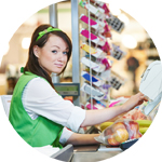 Female cashier profile photo working behind a cash drawer