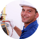 Electrician looking at the camera while using an electric meter
