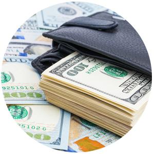 Many 100 dollar bills in a wallet