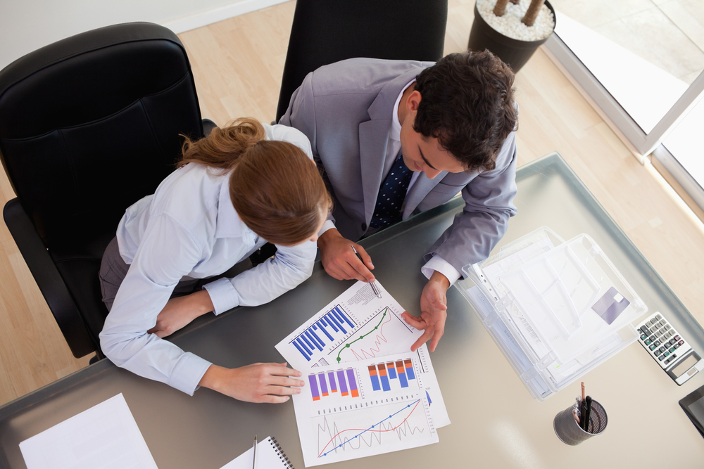 Above view of a management consultant analyzing data with her client