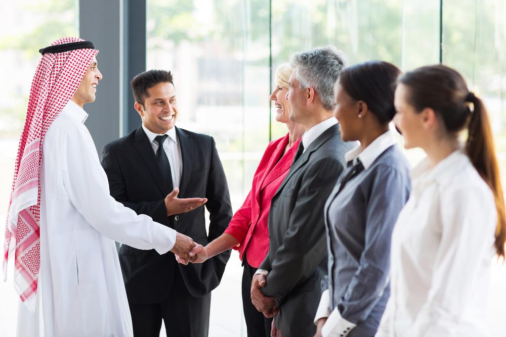 young translator introducing Arabian businessman