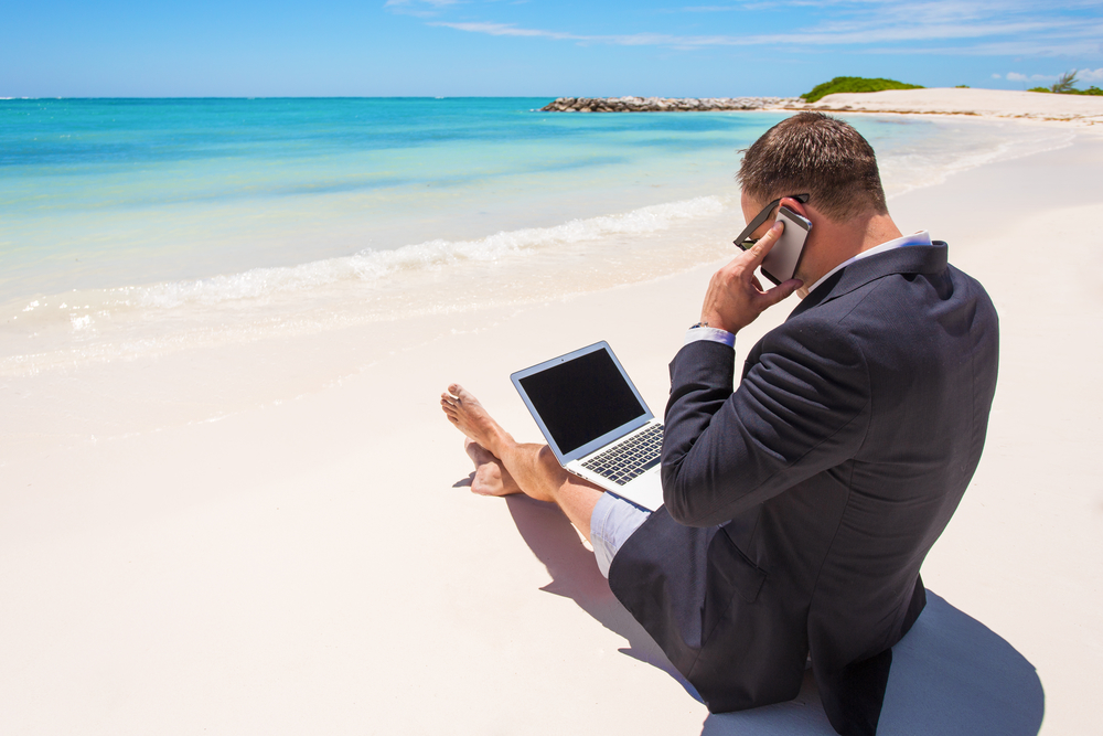 virtual recruiter working on the beach in business clothing