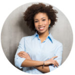 Female Afro Copywriter smiling at camera with arms crossed