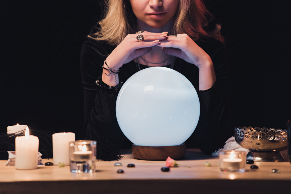 Psychic with Crystal Ball under her