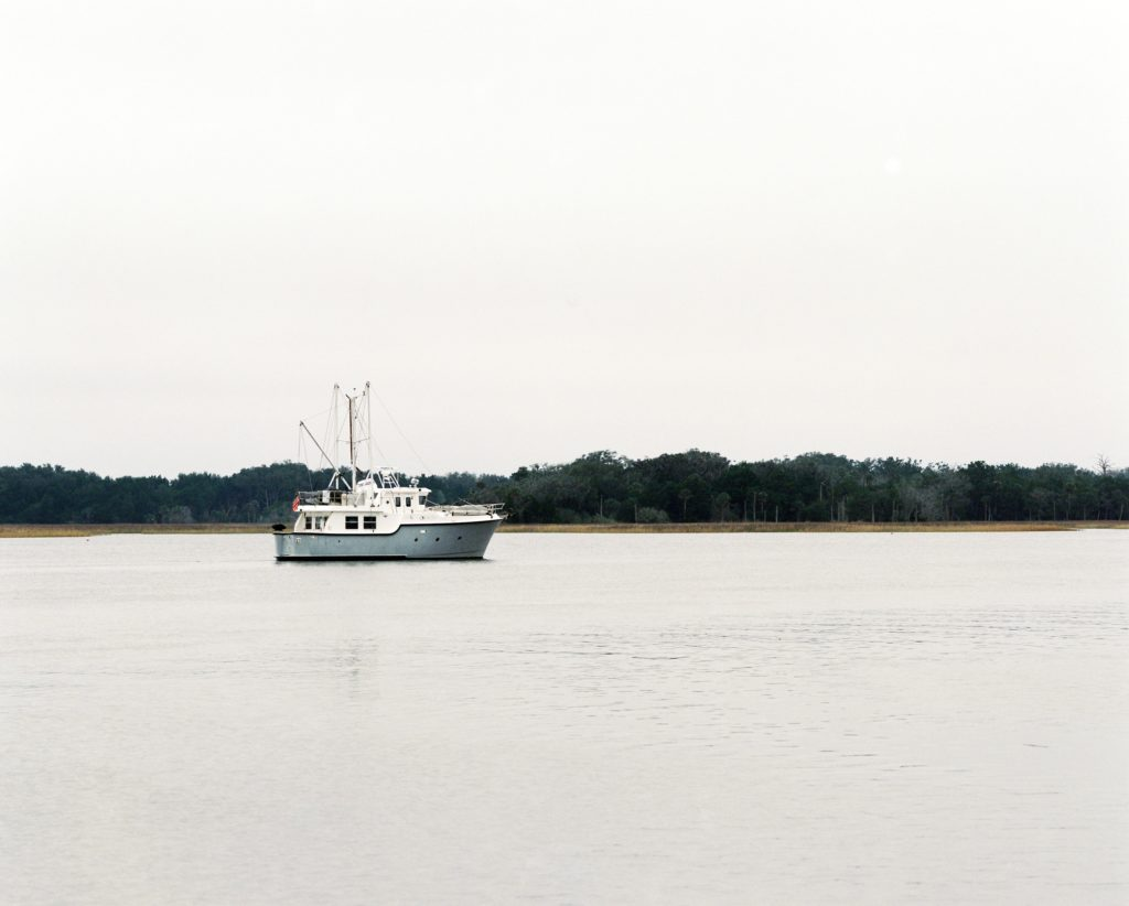Big white fishing boat on a lake or sea