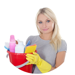 Blond cleaning lady holding up a cleaning supplies